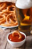 Fried onion rings and beer close-up on the table. vertical — Stock Photo