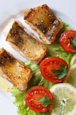 Perch fried fillet with vegetables. Closeup vertical top view — Stock Photo