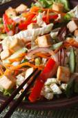 Healthy salad with tofu and fresh vegetables macro vertical — Stock Photo