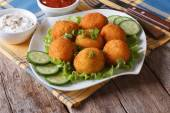 Potato croquettes with lettuce and cucumber horizontal — Stock Photo