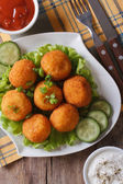 Potato croquettes with lettuce and cucumber top view vertical — Stock Photo