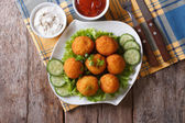 Potato croquettes with sour cream and ketchup top view — Stock Photo