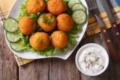 Potato croquettes with lettuce and cucumber top view horizontal — Stock Photo