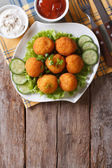 Croquette balls with sauce on a plate. vertical top view — Stock Photo