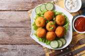 Potato croquette with sauce on a plate top view horizontal — Stock Photo