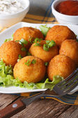Potato croquettes on a white plate close-up. vertical — Stock Photo