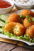 Potato balls deep fried on a plate  vertical — Stock Photo