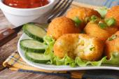 Potato balls fried on a plate horizontal — Stock Photo