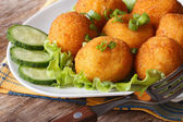 Potato croquettes and vegetables close-up. horizontal  — Stock Photo