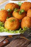 Potato croquettes and vegetables close-up. Vertical — Stock Photo