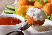 Potato croquettes with sour cream close-up in rustic style — Stock Photo