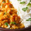 Shrimps in curry sauce with rice and cilantro vertical — Stock Photo #63702271
