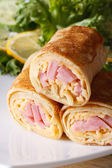 Pancakes stuffed with ham and cheese vertical macro — Stock Photo