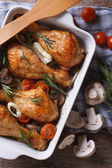 Baked Chicken drumsticks with vegetables closeup. vertical top v — Stock Photo