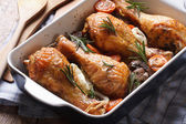 Chicken legs with rosemary in a baking dish close-up horizontal — Stock Photo