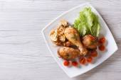 Chicken legs with mushrooms and tomatoes horizontal top view — Stock Photo