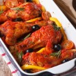 Chicken legs baked in tomato sauce with olives closeup. vertical — Stock Photo #65362045
