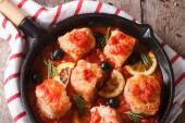 Fish fillet in tomato sauce in a pan closeup. horizontal top vie — Stock Photo