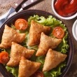 Samosa on a plate with sauce closeup, horizontal top view — Stock Photo #65771481