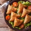 Samosa on a plate with sauce closeup, vertical top view — Stock Photo #65771537