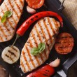Chicken fillet with vegetables in pan vertical top view closeup — Stock Photo #66689929