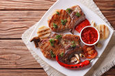 Pork steak with grilled vegetables on plate, horizontal top view — Stock Photo