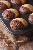 Colorful muffins in baking dish from the oven. vertical — Stock Photo