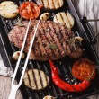 Tasty grilled beef steak and onions, eggplant, chili peppers — Stock Photo #68560679