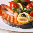 Grilled salmon steak and vegetable salad on a plate close-up — Stock Photo #71175009