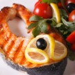 Grilled salmon steak and vegetable salad close up vertical — Stock Photo #71175073