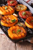 Grilled pumpkin and vegetables on grill pan. Vertical macro — Stock Photo