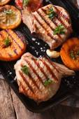 Grilled pork and pumpkin on a grill, Vertical top view macro  — Stock Photo