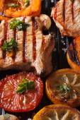 Grilled pork steak and vegetables on the grill. Vertical macro — Stock Photo