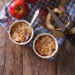 Apple crumble in portion pots on the table. vertical top view — Stock Photo #72137225