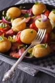 Delicious new potatoes with bacon and onions, vertical — Stock Photo