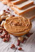 Peanut butter in a bowl close-up on a table vertical — Stock Photo