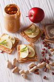 Delicious sandwiches with peanut butter and apple closeup — Stock Photo