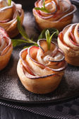 Healthy food: apple pie in the form of roses macro. Vertical — Stock Photo