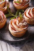 Apple dessert in the form of roses close-up. vertical — Stock Photo