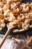 Homemade croutons with garlic macro. vertical rustic  — Stock Photo