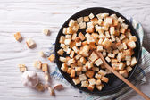 Homemade croutons in a bowl horizontal view top — Stock Photo