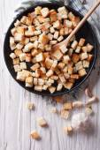 Delicious fried croutons with garlic vertical top view — Stock Photo