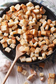 Homemade croutons vertical view above, rustic — Stock Photo