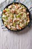 Caesar salad with chicken vertical top view  — Stock Photo