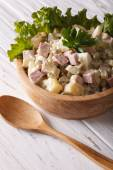 Russian salad Olivier close up in a wooden bowl. Vertical — Stock Photo