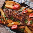 Homemade barbecue: meat and potatoes horizontal top view — Stock Photo #74355105
