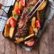 Homemade barbecue: meat and potatoes vertical top view — Stock Photo #74355109