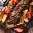 Pork ribs, potatoes close-up on a grill pan. vertical top view — Stock Photo #74355263
