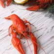 Crayfish boiled with lemon close up on a table. vertical — Stock Photo #75275829
