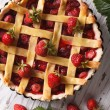 Strawberry cake close up in baking dish, vertical top view — Stock Photo #75681507